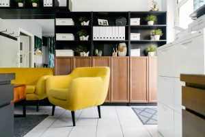 Image of yellow chairs with grey rug